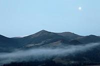 Full moon under Carpathian mountains