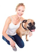 Pretty young woman smiling at you with her arm around her bull mastiff _ isolated