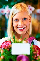 Portrait of a young florist holding out a beautiful bunch of flowers