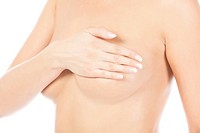 Breast cancer, woman holding her breast
