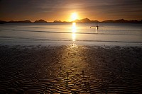A Boat Is Silhouetted At Sunset At The Beach, Corong Corong Bacuit Archipelago Palawan Philippines