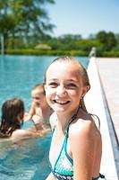 Smiling girl in swimming pool