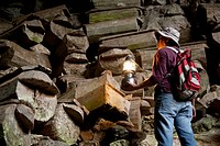 A Tour Guide Uses A Lantern To Look At The Many Coffins In The Entrance To Lumiang Burial Cave Near Sagada, Luzon Philippines