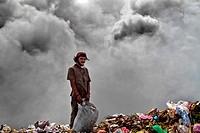 A Nicaraguan boy works on the burning pile of garbage in the garbage dump La Chureca, Managua, Nicaragua, 4 November 2004  La Chureca is the biggest g...