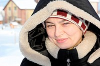 portrait of laughing girl in winter clothes