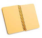 Notebook with yellow pages on a spira with shadow