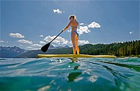 touring on the Stand Up Paddle Board at Redfish Lake in the Sawtooth Mountains near the town of Stanely in central Idaho
