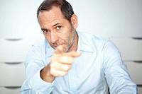 smart businessman points on you