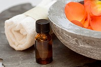 Wellness care products with petals and a towel