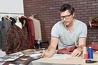 Mature male fashion designer working in design studio