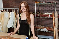 Portrait of beautiful young female dressmaker smiling