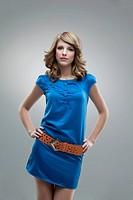 tall woman posing blue dress