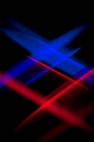 Blue and red lights crisscrossing against a black background