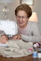 A senior woman sewing
