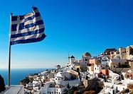 Oia scenery with Greece flag