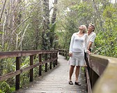 USA, Florida, Everglades, Couple looking for birdlife from boardwalk