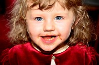 Portrait of a little girl eating chocolate