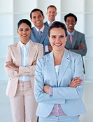 Businesswoman with her team smiling at the camera