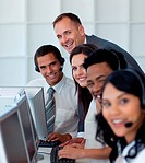 Ma ger with his business team working in a call center