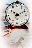 Old alarm clock with money