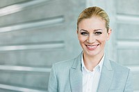 Germany, Stuttgart, Businesswoman smiling, portrait