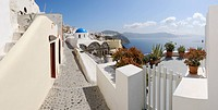 Greece, View of Oia village with cobbled path and gate at Santorini