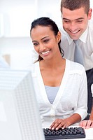 Businessman and businesswoman using a laptop