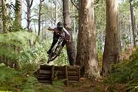 Portugal, Madeira, Mature man riding mountain bike
