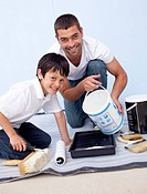 Father and son painting a room