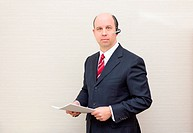 Business man with headset and document