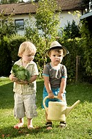 Germany, Bavaria, Boys with savoy and watering can