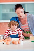 Beautiful mother and her son baking at home