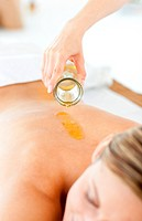 Beautiful woman having a massage with massage oil