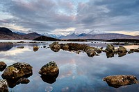 Snow covered mountains at dawn, Lochan na h Achlaise, Rannoch Moor, Argyll and Bute, Scottish Highlands, Scotland