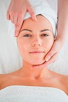 Portrait of a cute woman enjoying a facial massage