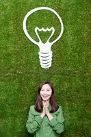 woman coming up with idea together under the bulb