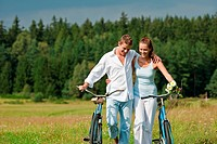 Summer _ romantic couple with old_fashioned bike