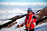 Wuman in red on ski slope