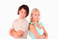 Unhappy serious couple looking into the camera