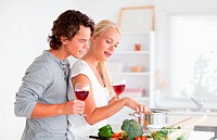 Young couple having a glass of red wine