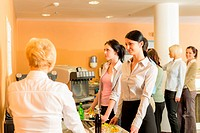 Cafeteria pay at cashier women in queue