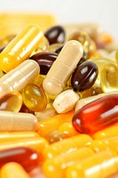 Composition with dietary supplement capsules.