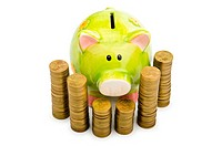 Piggy bank and coins isolated on white