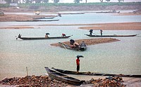 Stone workers collect stones in boats from the Dholai river in Bholaganj During monsoon season boulders, rocks, stones and pebbles wash up from India ...
