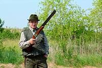 hunter posing with shotgun