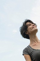 Woman smiling outdoors, low angle view