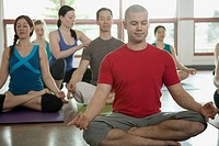 Yoga class in Lotus pose.