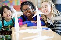 Elementary students displaying wind turbine models.