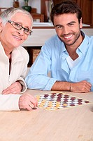 Mother and son playing draughts