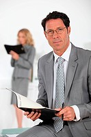 smiling businessman with book